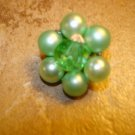 Vintage metal button with green pearls and green glass bead.