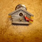 All metal bird house with little bird pin back badge.