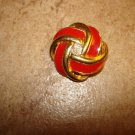Gold and red art nouveau style metal button.
