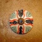 Large carved colorful faux bone button with rhinestone.