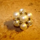 Vintage button with white pearls and metal back.