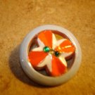 Nicely painted pierced plastic button with rhinestones.