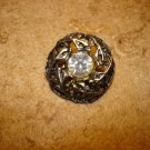Vintage cut steel pewter button with rhinestone.