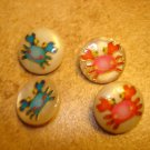 Lot of 4 funny buttons with sea snails or crabs.