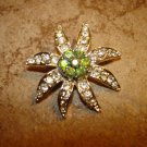 Large flower shape silver metal button with tiny rhinestones.