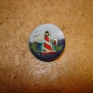 Nicely painted button with lighhouse.