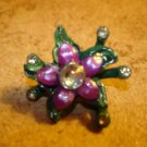 Pewter flower shape painted metal button with rhinestones.