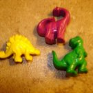 Lot of 3 plastic realistic dinosaurs buttons.