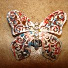 Large pierced metal butterfly button with tiny rhinestones.