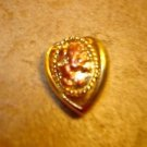 Heart shape gold metal button with lion.