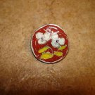 Signed silver metal button with white flower.