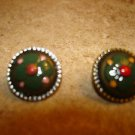 Set of 2 nicely painted old metal buttons.