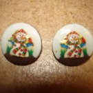 Set of 2 picture like Christmas buttons with colorful snowman.