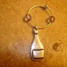 Silver metal bottle with glass beads and ring key chain.