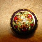 Vintage metal button with painted art nouveau patern.