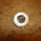 Vintage mother of pearl button with carved in inlay harp.