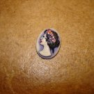 Oval plastic button with Roman lady bust.
