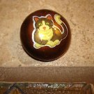 Large dome shape button with brown cat.