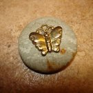 Vintage cloth and metal button with butterfly.