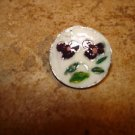 Signed silver metal button with purple flower.