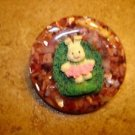 Large faux tortoise shell button with Easter bunny.