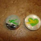 Lot of (2) Two mother of pearl like funny buttons.