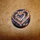 Old blue mother of pearl button with heart and pink rhinestones.