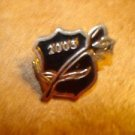 All metal pin badge 2005 with rose.