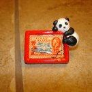 Chinese Panda bear with Cayman Island stamp button.