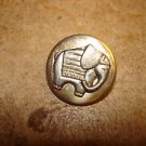 Old silver metal button with elephant.
