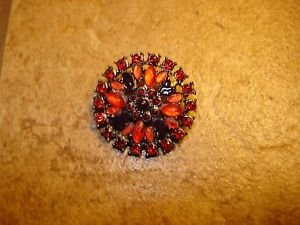Vintage metal button with beautiful red & purple rhinestones.