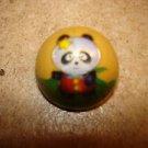Dome shape metal button with panda bear.