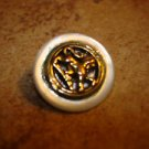 Old mother of pearl button with brass lion inlay.