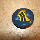Large plastic button with colorful tropical fish.