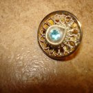 Delicate vintage metal  button with saphire color stone.