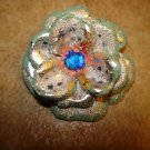 Large 3D flower shape painted metal button with blue rhienstone.