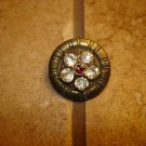 Vintage metal button with embeded rhinestone flower.