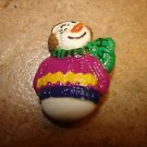 Christmas button with colorful snowman.