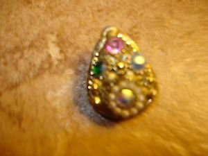 Tier shape metal button with rhinestones & tiny pearls.