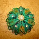 Large intrique plastic button with rhinestones and tiny pearls.