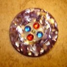 Large faux tortoise sheel button with rhinestones.