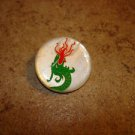 Old mother of pearl button with flaming Chinese dragon.