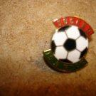 Soccer  is a kick all metal pin badge.