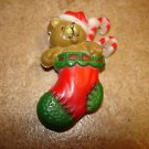 Cute Christmas plastic button teddy bear in Christmas stocking.