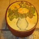 Old oval shape wood box with painted vase & flowers.