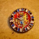 Large metal button with Japanese dragon.