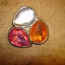Large metal button with tier shape nicely faceted glass stones.