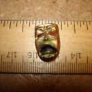 Old brass and mother of pearl button  Phantom of the opera.