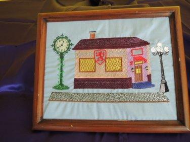 Framed embroidered artwork, pub scene