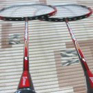Badminton racket, shuttles and grips.